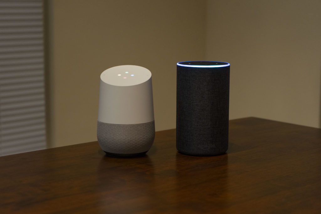 Google Home and Amazon Echo on a table