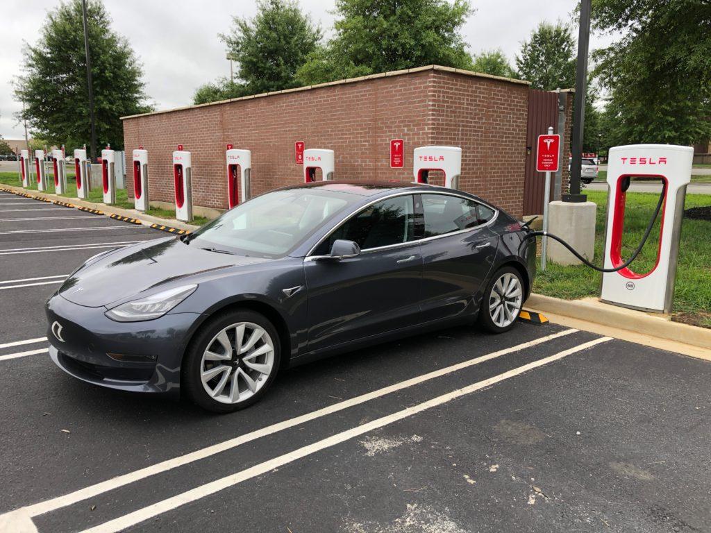 Tesla Model 3 parked at Supercharger