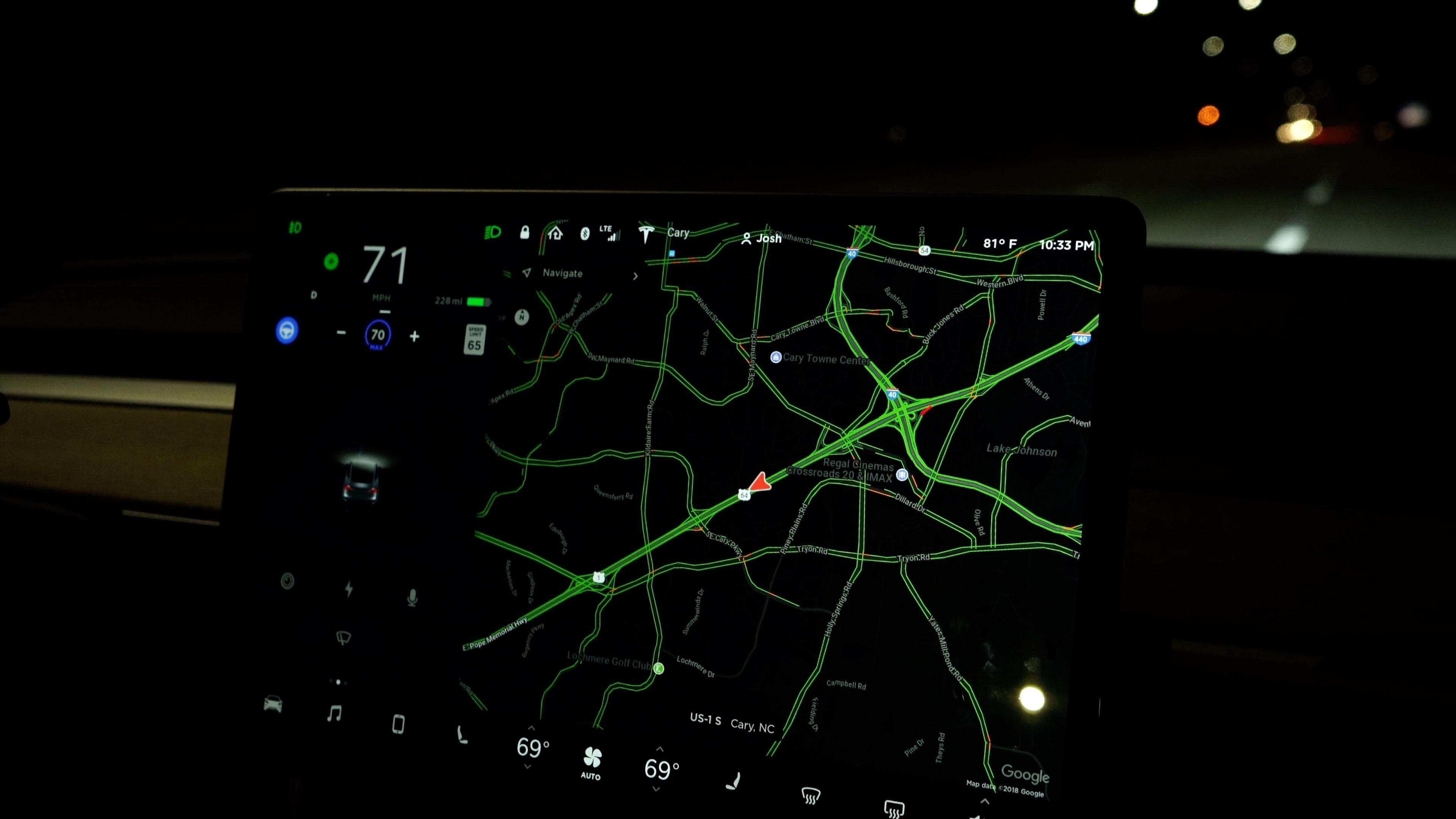 Tesla Model 3 Autopilot at night.